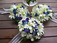 Bridesmaids Bouquets-wrap the stems with royal blue ribbon-leave the white ribbon out