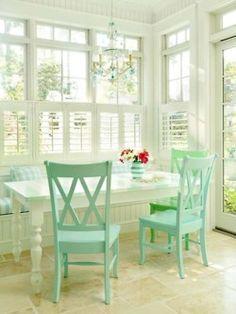 Beautiful breakfast nook....love the brightness and aqua color!