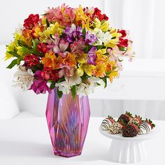 This abundant bouquet of alstroemeria, known as Peruvian lilies, will add vibrant color to any room. This colorful bouquet contains 100 blooms of Peruvian Lilies, 4-6 blooms per stem. To allow these beautiful flowers to last much longer, they are shipped fresh, budding, and ready to bloom. 6 gourmet dipped succulent strawberries make this gift extra special.