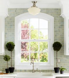 blue/green tile to the ceiling + wrapped around arched window