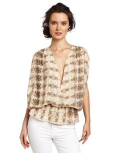 aryn K Women's Print Blouse, Taupe Python, Medium Aryn K. $76.00. Made in China. Shell: 100% Silk; Lining: 100% Polyester. Front closure and band waist. Dry Clean Only. Wrap animal print top with with clasp. Save 50%!