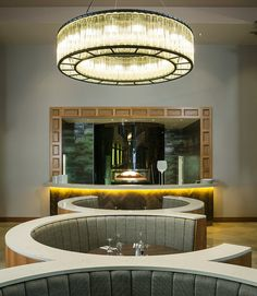 #interior #restaurant #bar #circular #booth #seating #pendant #decorative #chandelier #ring #glass #tubular #fluted