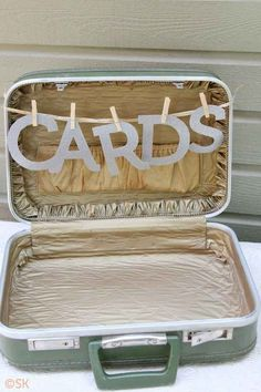 Use an old or thrifted suitcase as a card or gift box.