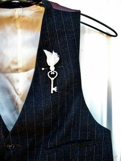 21 Most Unique Ceremony Ideas... A key instead of a flower for the groom for a vintage wedding.