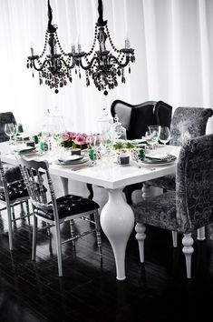 glam! Black chandelier, black chairs white table.