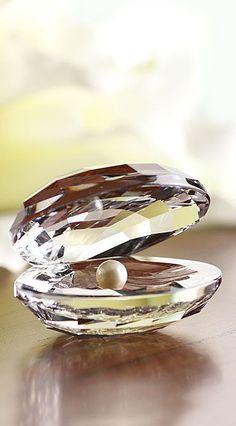 Swarovski aquatic shell with pearl inside.  Show me in pearls... (www.crystalclassics.com)