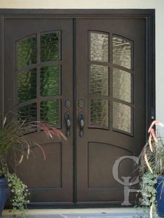Iron Double Door Clark Hall Iron Doors Charlotte, NC I really like these doors, the arched tops, the textured glass, I just wonder about the safety factor. House Front Door, Custom Front Doors, House Front, House Doors, Entrance Doors, Door Entryway, Iron Front Door, Traditional Doors, Doors