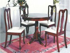Dark cherry dining table and high back chair - it is slightly retro style