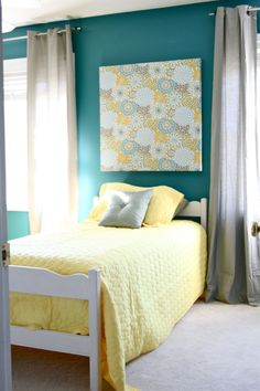 turquoise here is a bit bold, but I do like the combo with yellow and grey. Trying to keep the same comforter, so I'm not sure....
