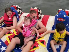 Madison about to go on her first Tube ride with her Daddy, big Sister, and big Cousin