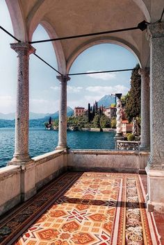 Domed and columned patio on the water in Lake Como, Italy.