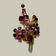 Shades of pink in floral bouquet pin.