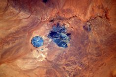 https://flic.kr/p/TEBi9u | Akjoujt | It is not easy to see borders from space, especially around the Sahara... this mine is in Mauritania where they have been excavating copper for many years. The village is the birthplace of the current president and also the person who dubs the voice of Morgan Freeman and Eddie Murphy (yes we dub films in France, and yes, I looked this up on the internet) :)  Intrigué par cette mine en plein Sahara, j'ai fait mes recherches : la petite ville à l'est de…