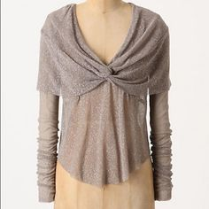 """Anthropologie Pellucidity Top taupe knotted vneck DETAILS A knotted cape overlay is knotted into a v-neck. By Edith 11. Perfect tucked into a skirt or layered over a tank. Never worn, tags attached. Not sparkly, more of a matte taupe    Polyester, spandex  Hand wash  20""""L  Imported  Style No. 23614233 Anthropologie Tops Blouses"""