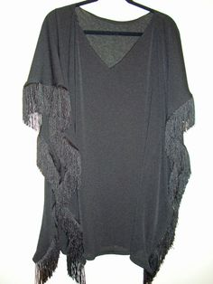 i have always dreamt of the day when i could make new clothes... now's as good a time as any! here's a kaftan!