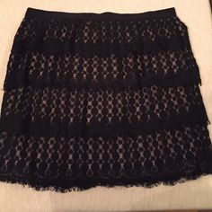 Ann Taylor lace tiered skirt Black lace tiered skirt, new with tags, never been worn.  Back zip. Elastic grosgrain waste band. Ann Taylor Skirts A-Line or Full