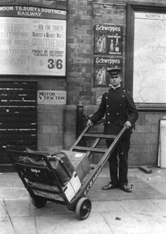 A railway porter stands with a trolley on a platform luggage weighing scale at Marleybone station in Next to hims is a cabinet full of destination labels to be pasted on to passengers' luggage (Photo by Topical Press Agency/Getty Images) London History, British History, Fine Art Prints, Framed Prints, Canvas Prints, Old Pictures, Old Photos, Nostalgia, Old Trains