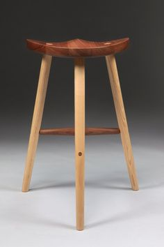 Stool made in sustainably sourced black walnut.