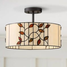A leaf-shaped motif adorns this semi-flushmount Tiffany style ceiling light in bronze. Top of shade to bottom of canopy is Style # at Lamps Plus. Semi Flush Ceiling Lights, Ceiling Light Fixtures, Tiffany Style Ceiling Lights, Red Leaves, Showcase Design, Light Decorations, Glass Art, Bronze, Bedroom Ceiling