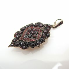 Victorian Gold Mourning Locket. Bohemian Garnet Locket Necklace With Pin Back & Hair Compartment Brooch. Antique Memento Mori Jewelry. by MercyMadge on Etsy https://www.etsy.com/listing/244312991/victorian-gold-mourning-locket-bohemian