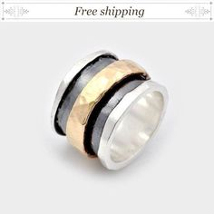 SALE Spinner fidget ring, Handmade Silver and Gold Spinning Ring This wide Spinner fidget ring makes a stunning presentation no matter what you are wearing. The wide silver band features an oxidized middle which offsets the spinning gold band. The spinning band makes a great