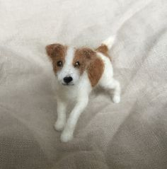 Here is a needle felted Jack Russell Terrier. A wool sculpture of your dog is a fun item, would make a great gift for the dog lover, and is a