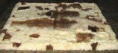 Baby alpaca fur rug, brown / white spots, from Peru