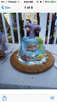 Mermaid cake. Mermaid tails made from fondant covered rice crispy treats. Bodies are made from fondant. Cake airbrushed with pearl.  Vanilla cakes filled with chocolate chocolate chip cream .