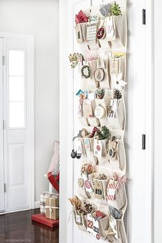 DIY an adorable woodland inspired Advent Calendar using an over-the-door organizer. Click to get the free printable tags.