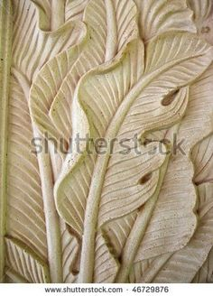 Traditional Balinese stone carving on sandstone by seanlean, via ShutterStock