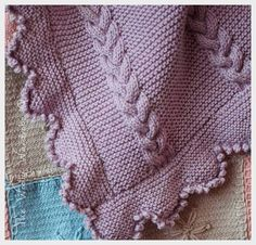 * This pattern is a PDF DOWNLOADABLE FILE ONLY * - not the finished garment.   This beautiful blanket is the perfect size for a baby cot. It is worked in garter stitch with panels of cable and has a border of garter stitch points and a picot edge both which are worked separate and