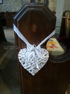 White wicker heart pew end, by Lily King Weddings