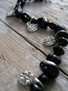 Black Beaded Bracelet and Silver Charms
