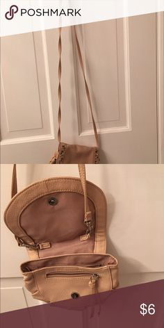 Small beige vinyl purse Candies brand.  Has an inside zipper compartment. Long strap. Snaps shit with metal decorations.  It is 7 inches across and 6 inches high. Candie's Bags Mini Bags