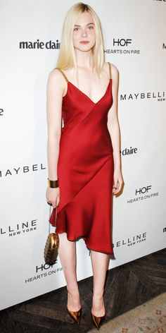 @Who What Wear - Elle Fanning in a Red Slip Dress. Love the combination of the red dress with metallic accessories