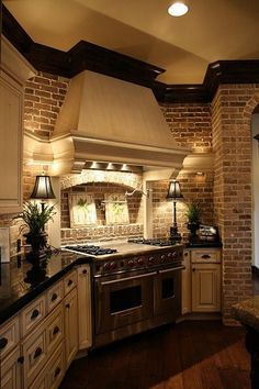 Different counter but love the brick and cabinets! Love love the indention in the backsplash behind the stove