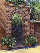 I LOVE this brick entry, the arch, the greenery, the iron gate.   Love, love.