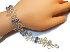Sterling silver filigree bracelet with blue agate caged beads $55 - use coupon code PIN15 to save 15% now. Just CLICK pic!