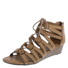 """Soon to become your go-to sandals this season, the Zoey from Brash features trendy ghillie lacing, ankle zipper, padded footbed, low 1 1/2"""" wedge, and a ribbed rubber outsole. Manmade materials."""