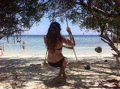 Backpacker girl on the Beach in Thailand. Beach swing!