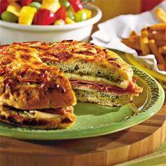 Pesto Foccacia Sandwich with Black Forest Ham, Roast Turkey, Provolone, Red Onions & Pesto on Foccacia or Ciabatta Bread | Southern Living