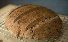Caraway-Rye Bread: To 2 cups mother, add ¾ t salt, 1 t honey, and 2 T caraway. Mix thoroughly. Stir in 1½ cups rye flour. Shown below, one BIG loaf made from a double batch, coated with egg-white wash, topped with caraway seeds, and baked for 35 minutes. (This loaf was covered during its rise with a thin cotton dishtowel, moistened throughout the day.)