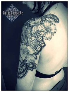 Lace tattoo by tattoo dagmar. I like the idea of a lace tattoo a lot.