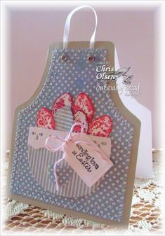 handcrafted Easter card ... apron format ... big pocket full of died eggs ... like the maching zig sewing to attach the top layer ... great design!!