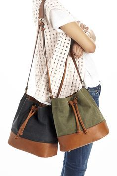 Washed olive & black canvas bucket bags with pebbled faux leather trim
