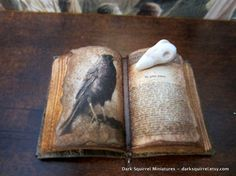 Raven Book and Skull set dollhouse miniature ooak by DarkSquirrel, $22.00  Just think about how tiny that is - 1/12 scale means it's probably an inch or so long.