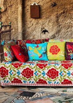 """Perenn""; great colors and pillows before a rustic wall. #boho #hacienda"
