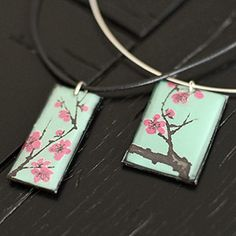 Pendant necklaces made from Arizona Iced Tea cans. I want to make keychains instead.