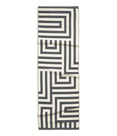 H&M | Cotton rug with a woven pattern.