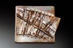 Brooch | Louise Tessing, Copper fold formed with copper stitching, riveting and seed pearls. Portfolio piece.